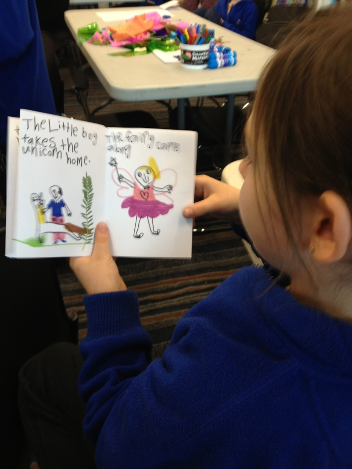 Student in Port Pirie proudly reading her book 'The Little Boy and the Unicorn' to her classmates