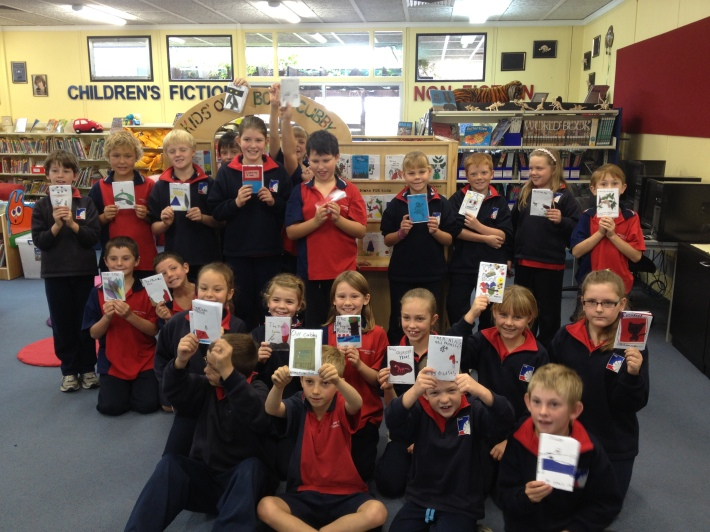Year 5 Kids at the Yorketown School Community Library with their published books