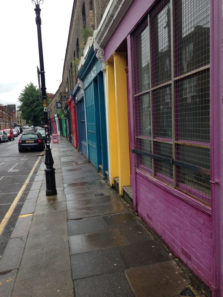 Coloured shopfronts along Columbia Street